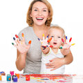 Happy young mother and child with painted hands isolated on white Royalty Free Stock Photo