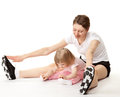 Happy young mother and her little daughter doing sport exercises white background Stock Photos