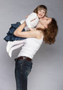 Happy young mother raising her little daughter smiling grey background Stock Photography