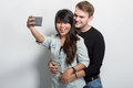 Happy young multiculture couple taking self camera together a potrait of Royalty Free Stock Photo