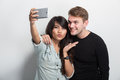 Happy young multiculture couple taking self camera together a potrait of Stock Photo