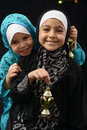 Happy Young Muslim Girls with Ramadan Lantern