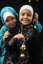 Happy Young Muslim Girls with Ramadan Lantern
