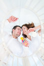 Happy young parents standing at bed of their baby baby the newborn Royalty Free Stock Photo