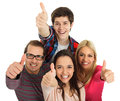 Happy young people four showing thumbs up on white background Royalty Free Stock Photos