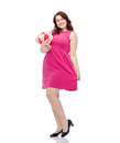 Happy young plus size woman with flower bunch holidays and people concept smiling posing in pink dress Royalty Free Stock Photography