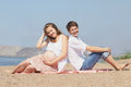 Happy young pregnant family at sea Royalty Free Stock Photography