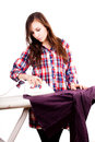Happy young pretty woman ironing clothes white background Stock Images