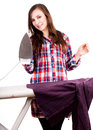 Happy young pretty woman ironing clothes white background Royalty Free Stock Photography