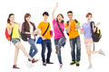 Happy young students standing a row isolated on white background Royalty Free Stock Photo