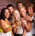 Happy young students toasting  drinks together Royalty Free Stock Photography
