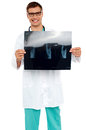 Happy young surgeon showing x-ray of a patient Stock Image