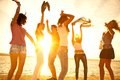 Happy young teens dancing beach beautiful summer sunset Royalty Free Stock Photography