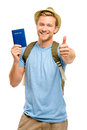 Happy young tourist man holding passport thumbs up white backgro smiling Stock Images