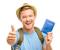 Happy young tourist man holding passport thumbs up white backgro smiling Royalty Free Stock Photos