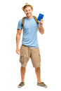 Happy young tourist man holding passport white background smiling Stock Image
