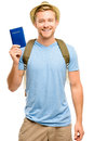 Happy young tourist man holding passport white background smiling Stock Photos