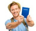 Happy young tourist man holding passport white background smiling Stock Photography