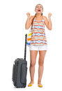 Happy young tourist woman with wheel bag enjoing vocation full length portrait of isolated on white Stock Images
