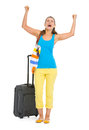 Happy young tourist woman wheel bag rejoicing white Royalty Free Stock Photography