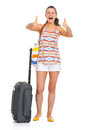 Happy young tourist woman wheel bag showing thumbs up Royalty Free Stock Photo