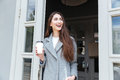 Happy young trendy woman drinking take away coffee Royalty Free Stock Photo
