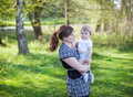 Happy young woman and  baby boy in summer forest Stock Images