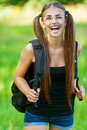 Happy young woman with backpack Royalty Free Stock Images