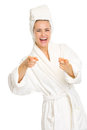 Happy young woman bathrobe pointing camera isolated white Royalty Free Stock Photo