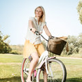 Happy Young Woman with Bicycle Royalty Free Stock Images