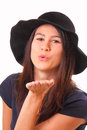 Happy young woman in a black hat Stock Image