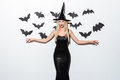 Happy young woman in black wich halloween costume with hat Royalty Free Stock Photo