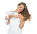 Happy young woman blow dry isolated on white background Stock Images