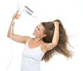 Happy young woman blow dry isolated on white background Stock Image