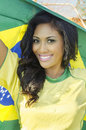 Happy young woman in brazil football top pretty beautiful wearing soccer holding brazilian national flag concept image for Royalty Free Stock Photos
