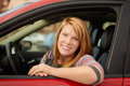 Happy young woman in car portrait Stock Images