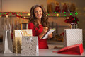 Happy young woman checking list of christmas presents Royalty Free Stock Photo