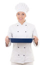 Happy young woman in chef uniform holding ceramic platter isolat isolated on white background Stock Photo