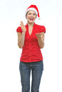 Happy young woman in Christmas hat clapping hands Stock Images