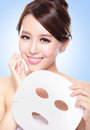 Happy young woman with cloth facial mask isolated on blue background concept for skin care asian Stock Photo