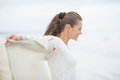 Happy young woman on cold beach rejoicing lonely Royalty Free Stock Image