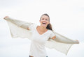 Happy young woman on cold beach rejoicing pretty Stock Photo