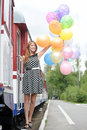 Happy young woman with colorful latex balloons outdoors Royalty Free Stock Photography
