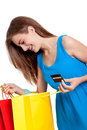 Happy young woman with colorful shopping bags visa isolated credit card Royalty Free Stock Photography