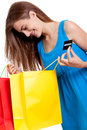 Happy young woman with colorful shopping bags visa isolated credit card Stock Photo