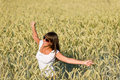 Happy young woman in corn field enjoy sunset Royalty Free Stock Photography