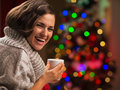 Happy young woman with cup of hot chocolate Stock Photography