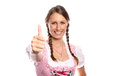Happy young woman in a dirndl giving a thumbs up pinkish symbol for success and happiness oktoberfest concept isolated on white Stock Images