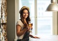 Happy young woman drinking beer at bar or pub Royalty Free Stock Photo