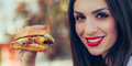 Happy young woman eat tasty fast food burger Royalty Free Stock Photo